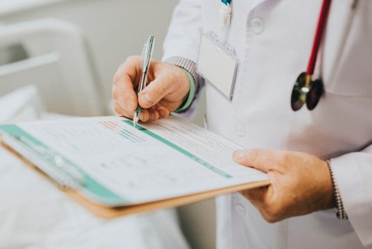 medical center CHI Saint Joseph: doctor with a white lab coat and stethoscope writing on a clipboard