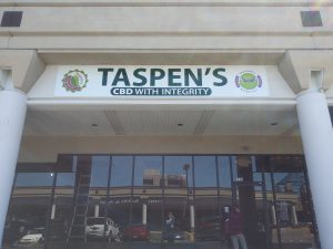 Business: front face of a building that has a sign that says Taspen's