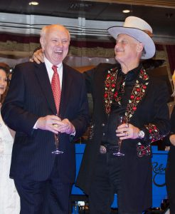 Food: two men dressed up smiling and laughing