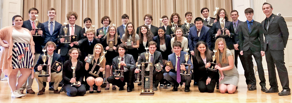 Parents: group of high schoolers posing with tropheys