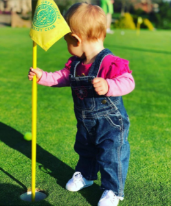Greenbrier: a young child holding a mini flag for a golf course