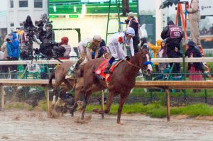 Lexington: jockey racing a horse