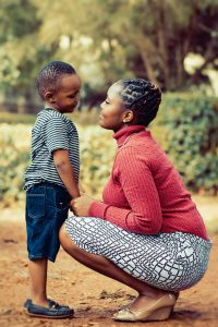 Mother's Day: woman and her son looking at each other