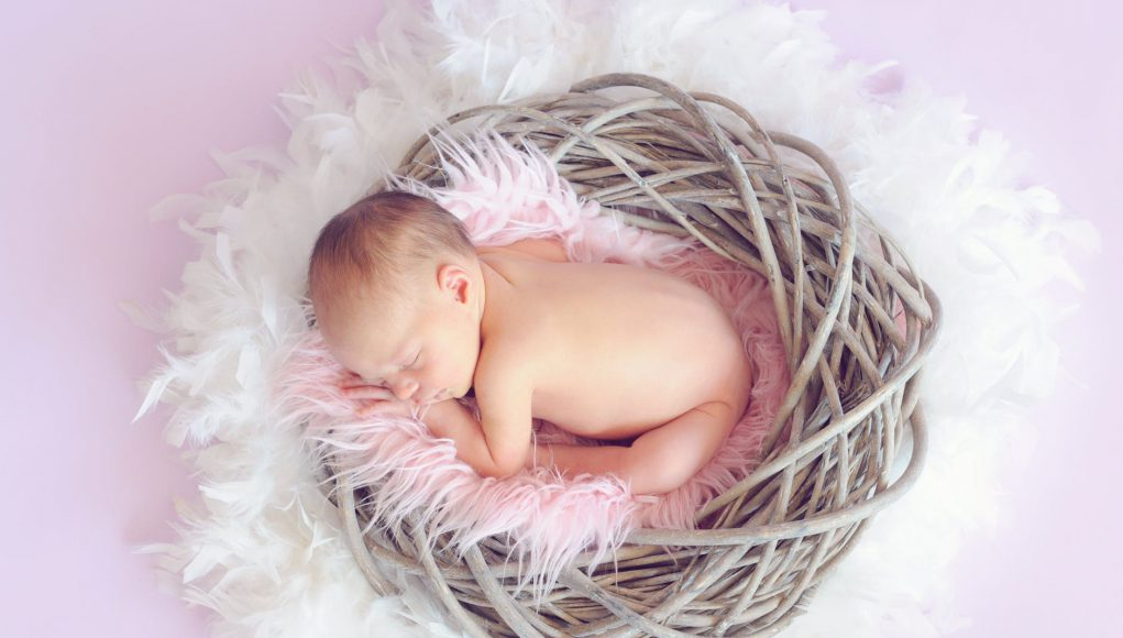 Mother's Day: a baby in a basket sleeping