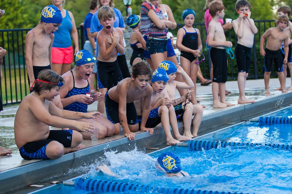 Camps: group of kids competing in swimming