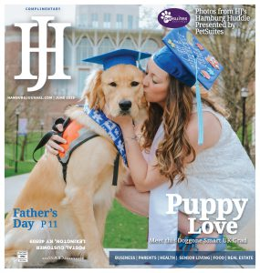 Hamburg Journal June 2019 Cover featuring a service dog and its trainer in graduation caps. gril is kissing dog. Dog is a golden retriver.