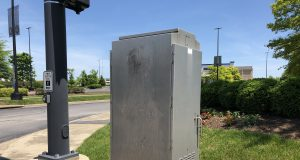 gray Traffic Box at an intersection