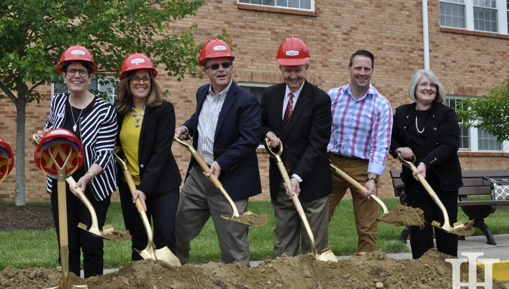 Senior: group of people in hard hats with shovels possing