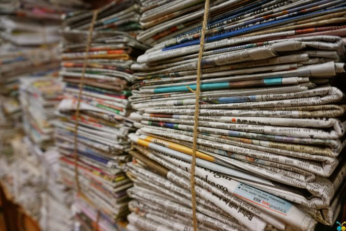 Paper Recycling: a stack of newspaper tied by string