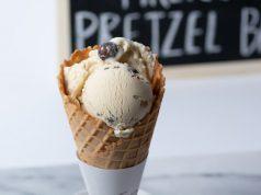 Graeter's Ice Cream: ice cream cone with a chalk board in the back ground