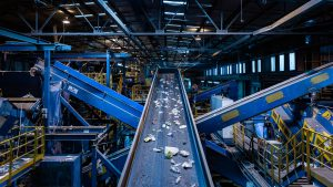 Home and Garden Recycle Center: a conveyor with recyclables