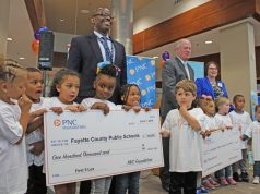 Parents Fayette County Public Schools: group of adults and kids holding up big checks