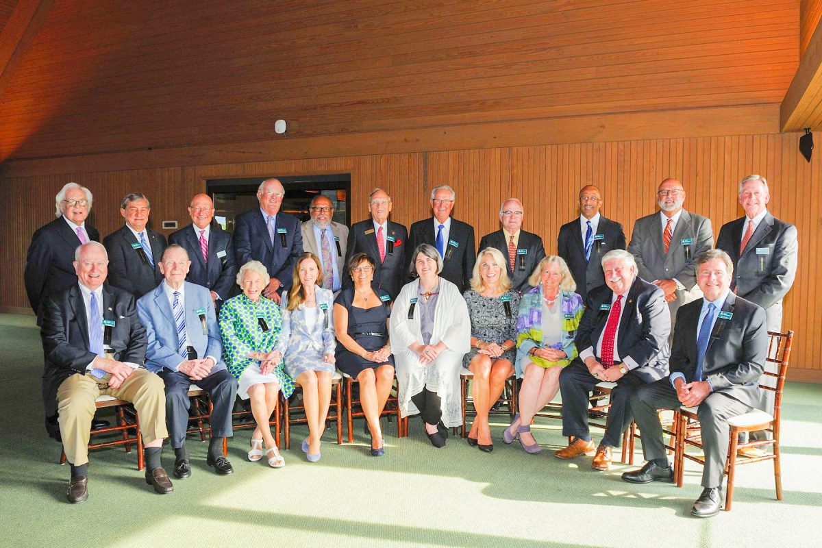 Business Hall of Fame: group of people sitting and standing smiling at the camera