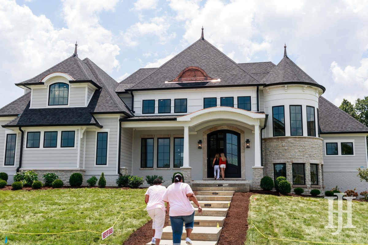 Grand Tour: outside view of people walking in and out of a home