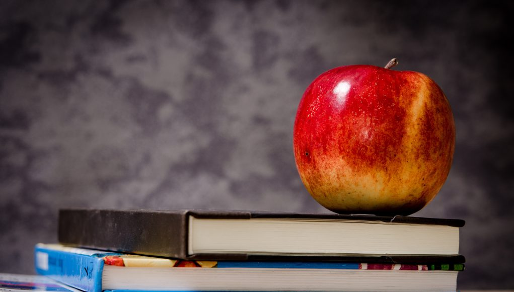 merit scholarships school Parents: blackboard with books on a desk and an apple