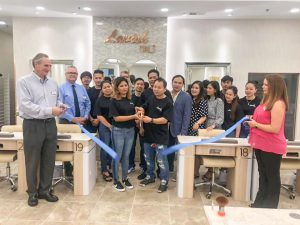 Business: group of people cutting a blue ribbon