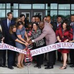 Brenda Cowan: group of people cutting a ribbon