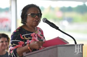 Brenda Cowan: woman speaking at a podium