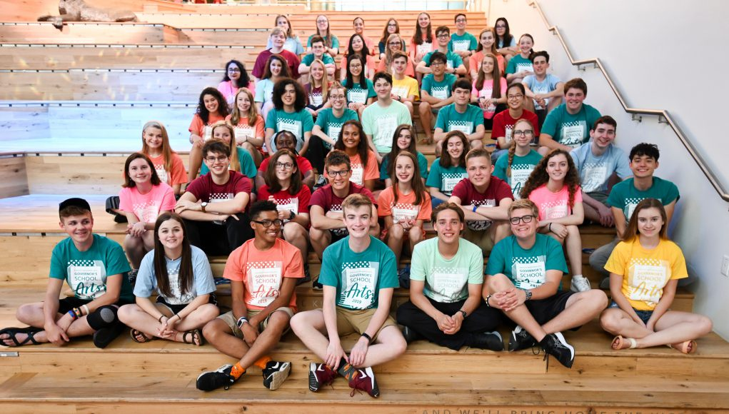 Kentucky: group of kids in different color shirts sitting on large steps
