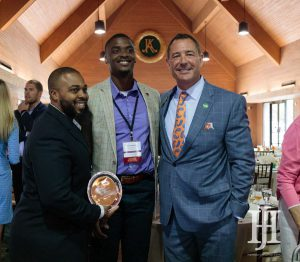 Small Business: three men smiling at the camera holding an award