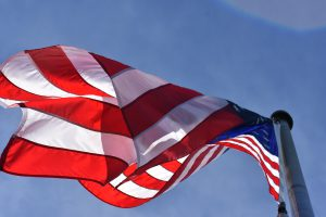 Labor Day: a flag waving on a flag pole