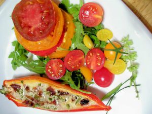 Chef Tom: tomatoes, lettuce, and other foods on a white plate
