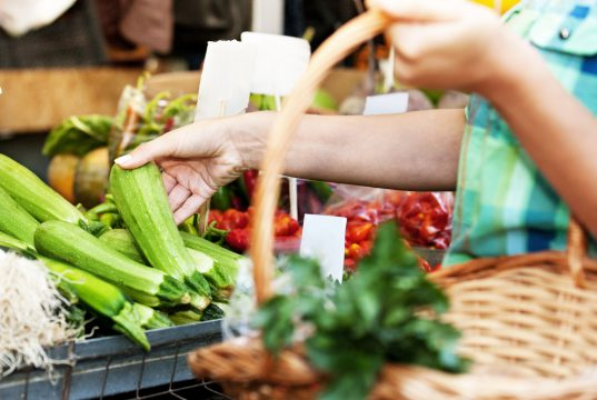 Health: Close up concept. Picking vegetables at local green market.
