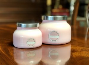 celebrate: pink candles on a wooden table