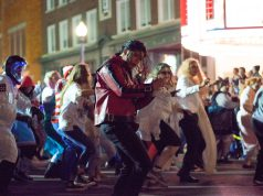 Halloween: a man dressed as michael jackson's thriller dancing in the street