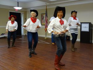 Lexington Senior Living: a group of older women dressed like cowgirls and dancing