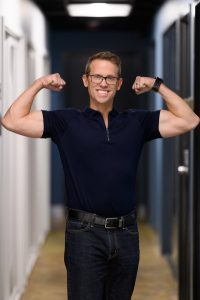 Health: a man in a black shirt flexing