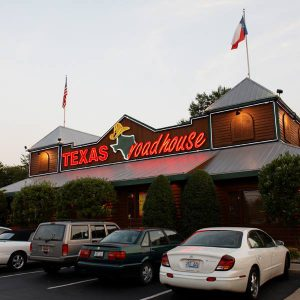 restaurant with Texas Roadhouse in red letters