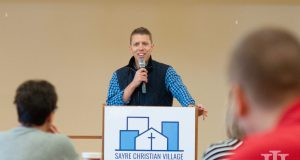 Senior Living: a man talking at a podium