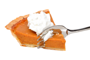 Holiday: pumpkin pie with a fork going through it