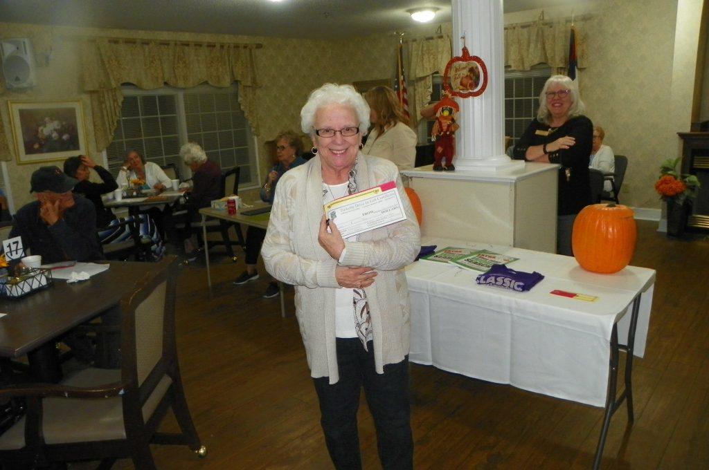 Senior Living: a woman holding something