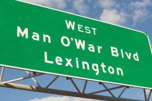 green sign that says Man O' War Boulevard