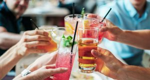bars: group of people cheersing with alcoholic drinks
