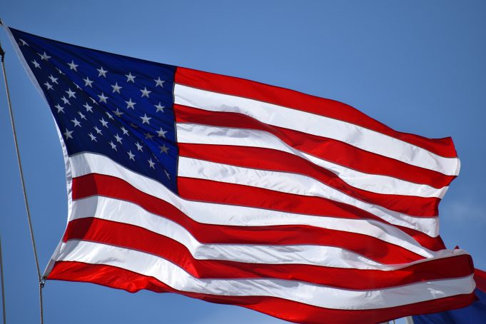 Veterans Day: flag flying in a clear blue sky