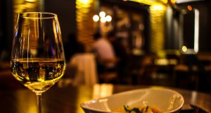 New Year's Eve: a glass of wine with a bowl of food